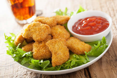 fast food chicken nuggets with ketchup, french fries, cola 版權商用圖片