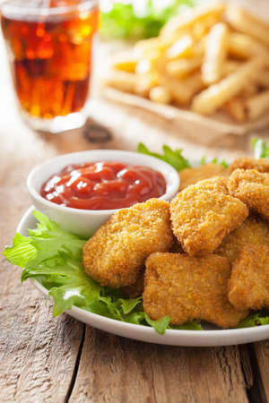 fast food chicken nuggets with ketchup, french fries, cola Stockfoto