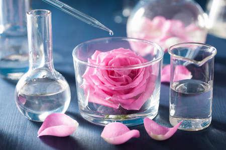 錬金術とバラの花と化学のフラスコとアロマテラピー 写真素材
