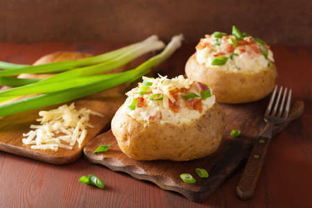 jacket potato: baked potato in jacket with bacon and cheese