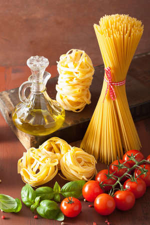 unboiled: raw pasta olive oil tomatoes. italian cooking in rustic kitchen