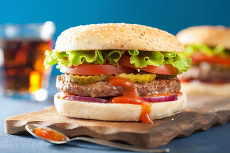 'food and beverage: burger with beef patty lettuce onion tomato ketchup