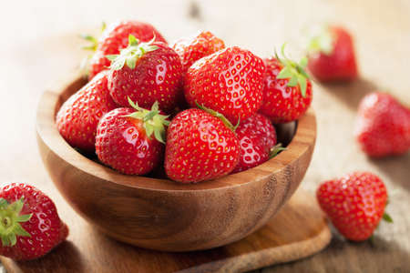 fresh strawberry in wooden bowl Stock Photo