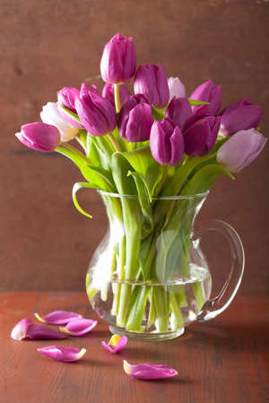 tulips in vase: beautiful purple tulip flowers bouquet in vase Stock Photo