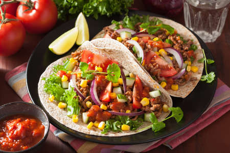 taco tortilla: mexican tacos with beef, tomato salsa, onion, corn