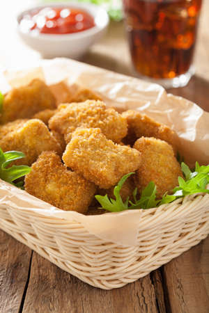 nuggets: fast food chicken nuggets with ketchup, french fries, cola Stock Photo
