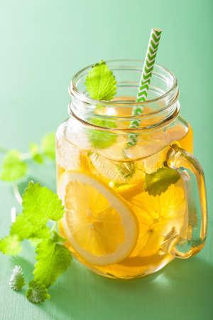 ice tea: ice tea with lemon and melissa in mason jars