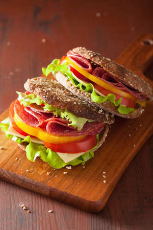 pepper salami: healthy sandwich with salami tomato pepper and lettuce