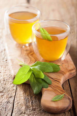 sage: herbal sage tea with green leaf in glass cup Stock Photo