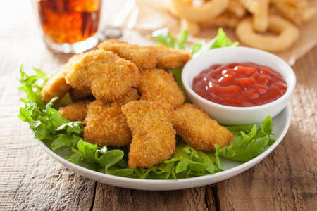 chickens: fast food chicken nuggets with ketchup, french fries, cola Stock Photo