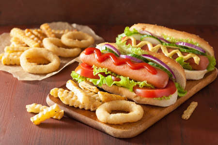 junks: hotdog with ketchup mustard vegetables and french fries Stock Photo