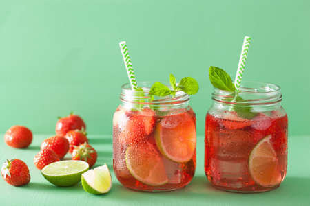summer strawberry lemonade with lime and mint in jars Stock Photo
