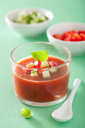 gazpacho: cold gazpacho soup in glass and ingredients