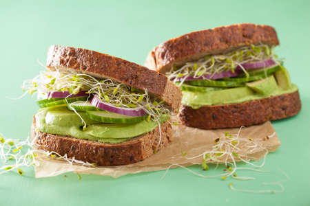 sandwich spread: healthy rye sandwich with avocado cucumber alfalfa sprouts Stock Photo