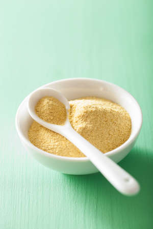 vegan nutritional yeast flakes in bowl Stock fotó - 43492852