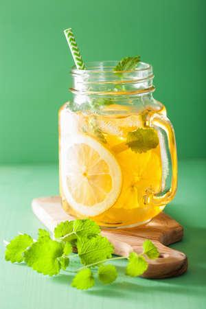 melissa: ice tea with lemon and melissa in mason jar
