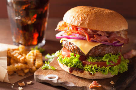 rustic food: bacon cheese burger with beef patty tomato onion cola Stock Photo
