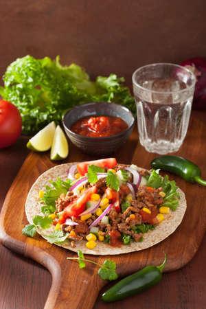corn tortilla: mexican taco with beef tomato salsa onion corn Stock Photo
