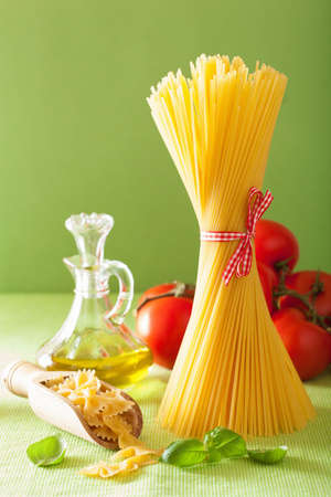unboiled: raw pasta olive oil tomatoes. italian cuisine
