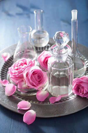 flasks: aromatherapy set with rose flowers and flasks