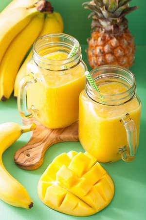 mango: healthy mango pineapple smoothie in mason jars