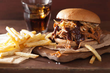classic burger: homemade pulled pork burger with coleslaw and bbq sauce