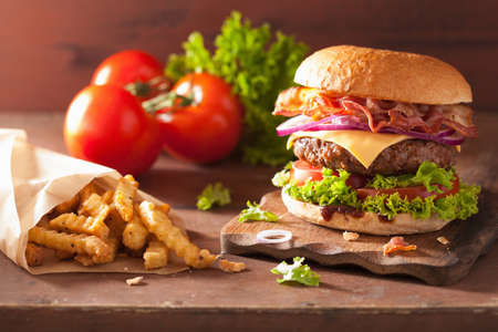 bacon cheese hamburger with beef patty tomato onion