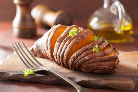 baked: Baked hasselback potatoes Stock Photo