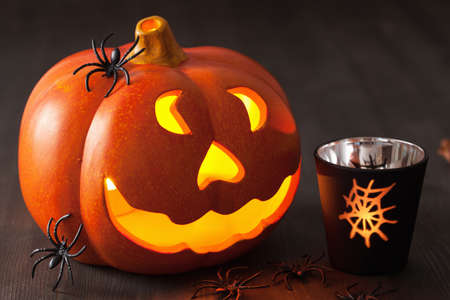 jack o  lantern: Halloween Jack O Lantern pumpkin spiders candles Stock Photo