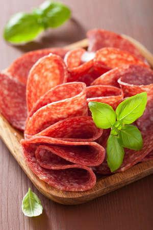 salami slices: salami slices in wooden plate