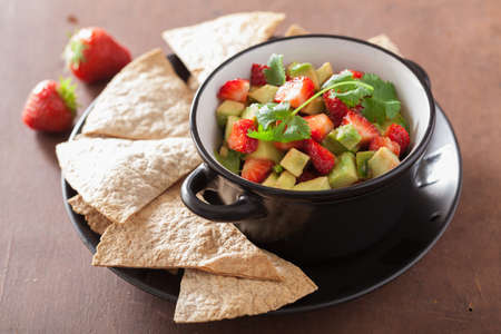 chips and salsa: avocado strawberry salsa with tortilla chips Stock Photo