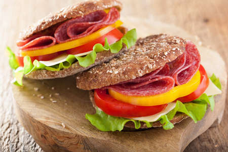 pepper salami: healthy salami sandwich with tomato pepper and lettuce