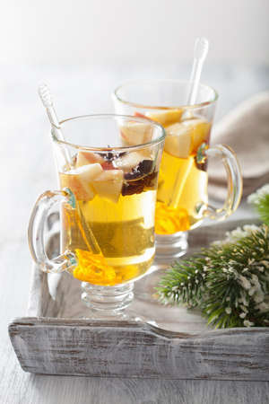 spiced: glass of mulled apple cider with orange and spices, winter drink