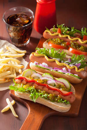 rustic food: grilled hot dogs with vegetables ketchup mustard