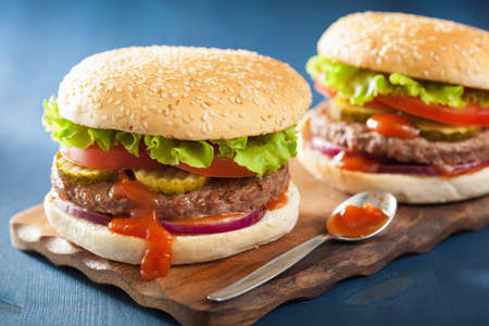 delicious food: burger with beef patty lettuce onion tomato ketchup