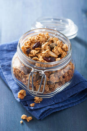 dried food: homemade healthy granola in glass jar Stock Photo