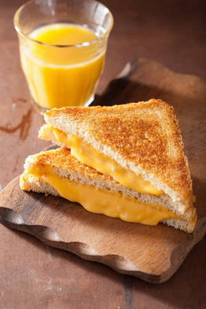 slices of bread: homemade grilled cheese sandwich for breakfast Stock Photo
