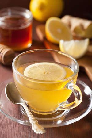 ginger health: hot lemon ginger honey tea in glass cup