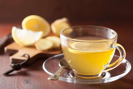 lemon slices: hot lemon ginger tea in glass cup Stock Photo