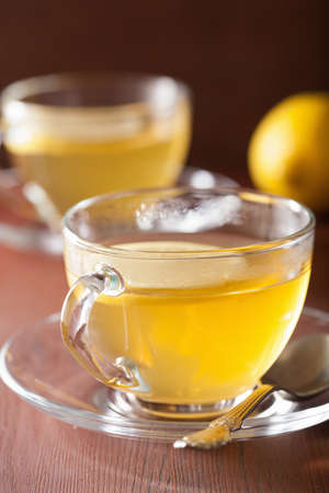 glass cup: hot lemon ginger tea in glass cup Stock Photo