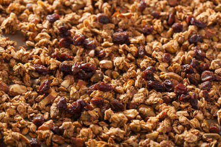 backing: homemade healthy granola on backing paper background Stock Photo