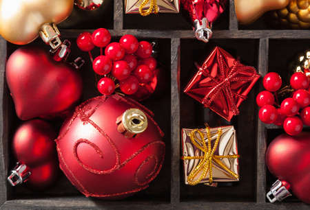 red christmas ball: christmas gift and decoration in wooden box