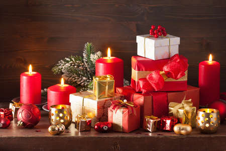 christmas candles: red and golden christmas gift boxes decoration candles