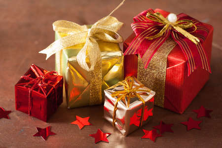 golden star: red and golden christmas gift boxes and decoration Stock Photo
