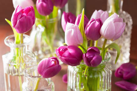 green flowers: beautiful purple tulip flowers bouquet in vase Stock Photo