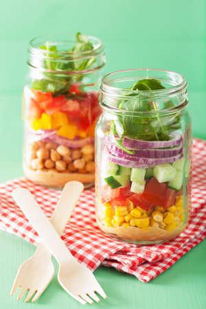 jars: healthy vegetable chickpea salad in mason jar