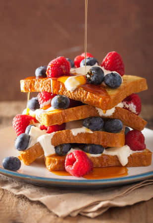 toast: french toasts with creme fraiche and berries for breakfast