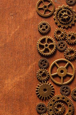 rusty: steampunk mechanical cogs gears wheels on wooden background