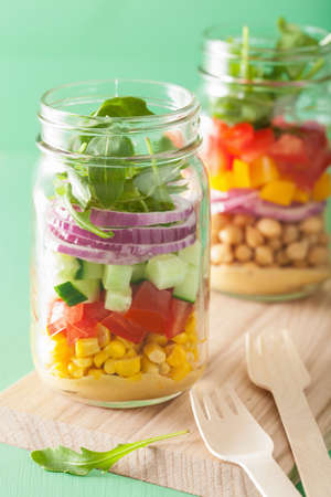 healthy vegetable chickpea salad in mason jar