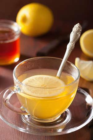 hot lemon ginger tea in glass cup Фото со стока